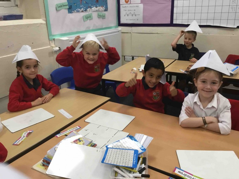 Children wearing the paper paddington hats they made