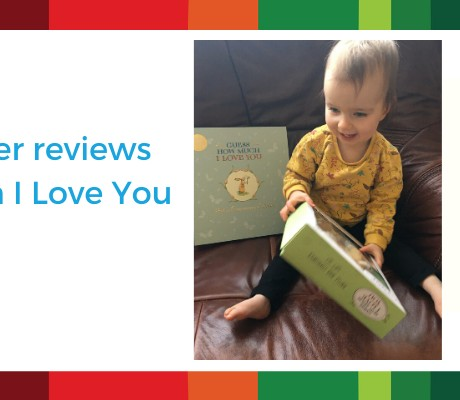Picture of baby reading Guess How Much I Love you board book and toy